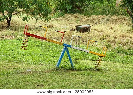 An Old, But Colorful, See Saw In An African Playground Area.