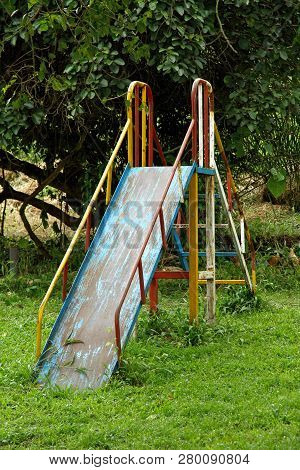 A Rusted Old Metal Slidei N A Playground In Africa