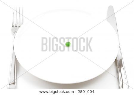 Single Pea On A Plate
