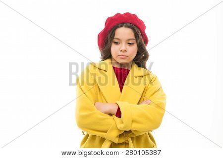 Sad Child. Sadness Concept. Girl Kid Wear Coat Hat Stand With Crossed Arms On Chest. Unhappy But Con