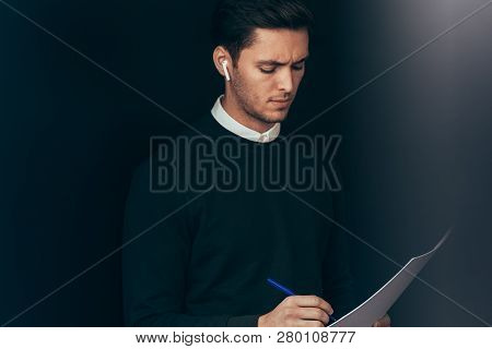 Young Handsome Man Have A Conversation With Colleagues During Meeting From Wireless Earphones. Cauca