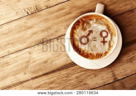 Symbol Of Gender Equality On The Coffee Foam In Wooden Table. Concept Of Gender Equality