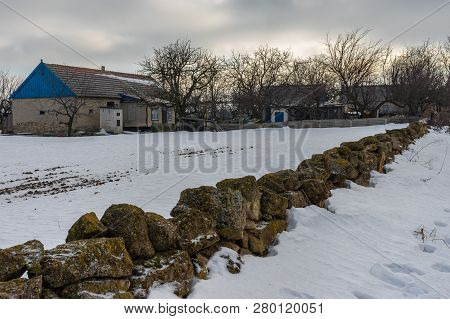 Winter Landscape With Peasant Homestead Surrounded With Small Stone Wall In Skelky Village, Zaporizh