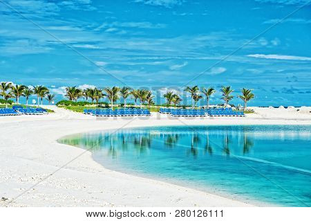 Tropical Beach In Great Stirrup Cay, Bahamas. Sea Shore, White Sand, Palm Trees On Blue Sky. Summer