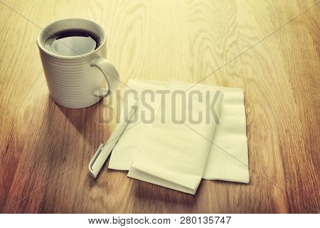 Instagram Effect - White Napkin Or Serviette And Pen On Oak Surface, Ideal For Notes And Phone Numbe