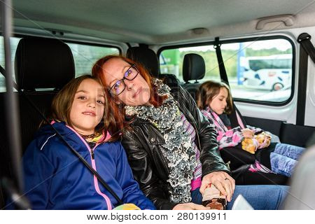 Family Travelling In Minivan To Airport.