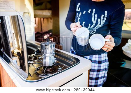 Cooking Coffee In Campervan, Caravan Or Rv On Camping Trip.