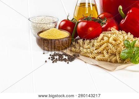Italian Food Ingredients - Ingredients For Italian Cooking, Basil, Bronze Die Fusili Pasta. Red Caps