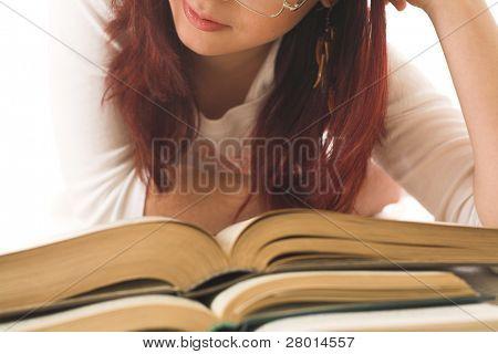 girl reading big books isolated on white