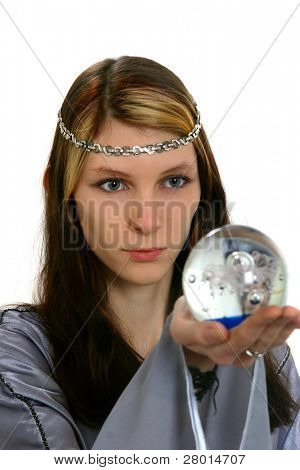 woman in long-sleeved dress gaze into the magic sphere