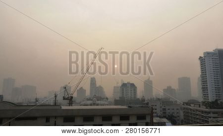Sukhumvit area in Bangkok city covered by smog and pollution. Thailand.