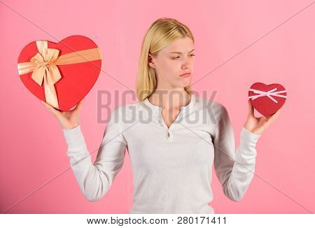 Does Size Really Matter. Woman Hold Big And Little Heart Shaped Gift Boxes. Which One She Prefer. Gi