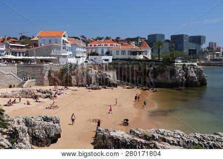 Cascais, Portugal - May 21, 2018: Tourists Visit Pescadores Beach (praia Dos Pescadores) In Downtown