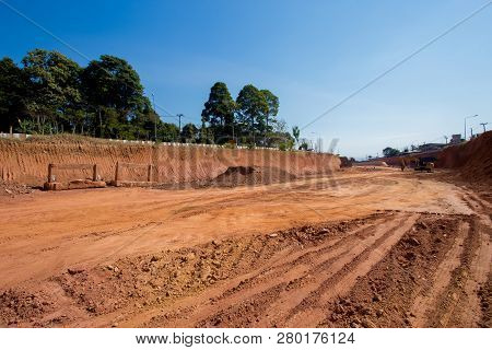 The Motor Grader Working On Road Construction