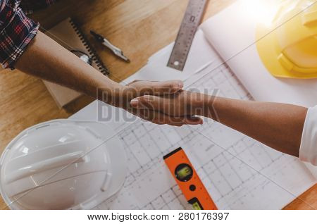 Top View Construction Worker Team Contractor Hand Shake After Finishing Up Business Meeting To Greet
