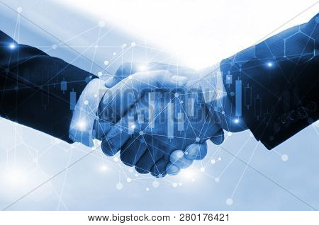 Business Man Or Investor Handshake On With Graph Chart Of Stock Market And Network Connection Graphi