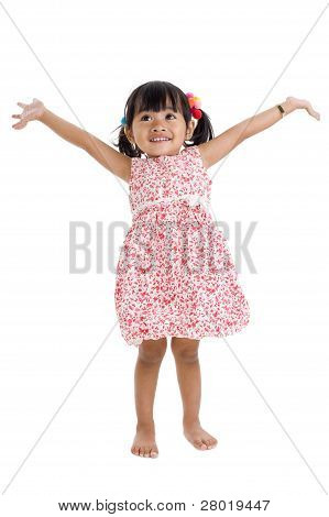 Girl In Studio With Arms Outstretched