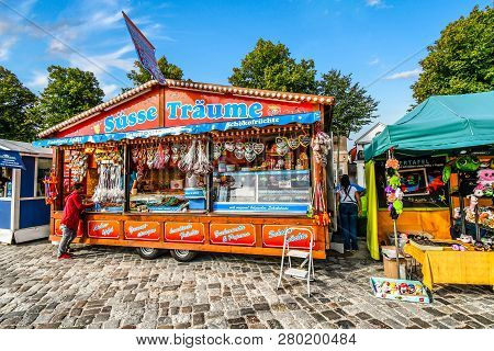 Warnemunde Rostock, Germany - September 5 2018: A Customer Orders From A Colorful Street Vendor On T