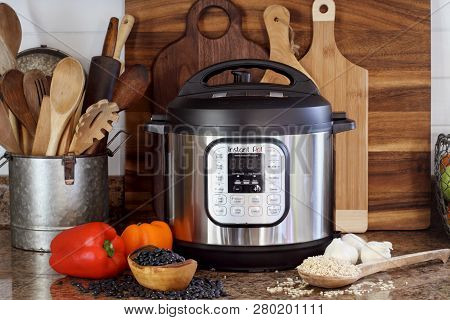 Breeding, Ky, Usa - January 08, 2019: Instant Pot Pressure Cooker On Kitchen Counter With Beans And