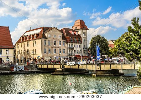 Warnemunde Rostock, Germany - September 5 2018: Tourists Cross The Bridge Over The Alter Strom Canal
