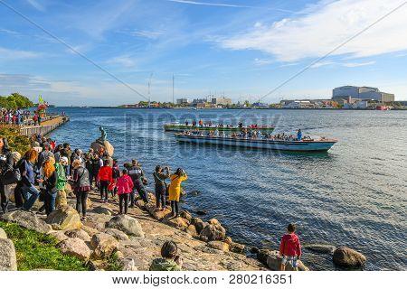 Copenhagen, Denmark - September 12 2018: Tourists Surround The Little Mermaid Statue On The Langelin