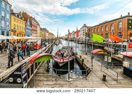 Copenhagen, Denmark - September23 2018: Tourists Sightsee, Board Guide Boats And Dine At Sidewalk Ca