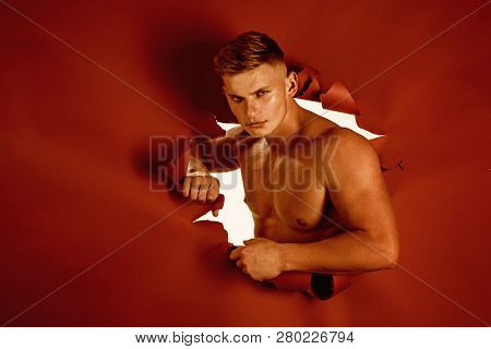 His Ambition Realised. Strong Man Breaking Through Paper. Sport Man With Muscular Strength. Sport Tr