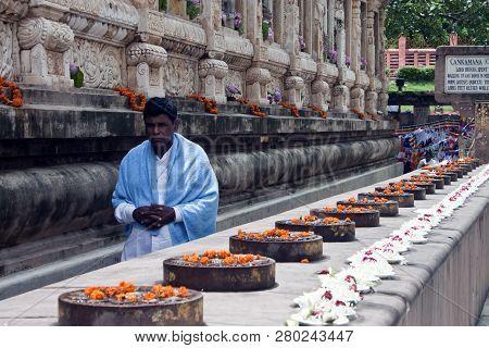 Bodhgaya, India - August 13, 2011: Devotte Next To The Mahabodhi Temple In Bodhgaya, India. Bodhgaya