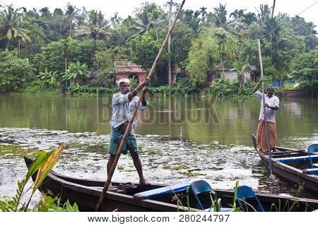 Backwaters, India - August 24: Men In Canoe On August 24, 2011 In Backwaters, India. The Kerala Back