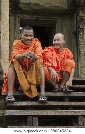 Siem Riep, Cambodia - Oct 9, 2011: Monks Sitting On Steps Of Angkor Wat, Cambodia