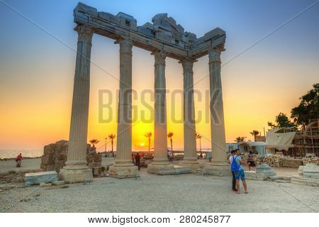 Side, Turkey - June 8, 2018: People at the Temple of Apollo in Side at sunset, Turkey. Side  is an ancient Greek city on the southern Mediterranean coast of Turkey.