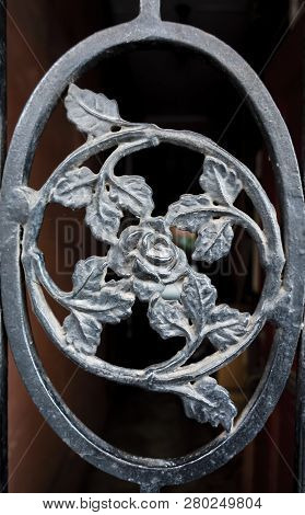 Wrought Ironwork With Rose Flower Pattern Motif From An External Entrance Gate.