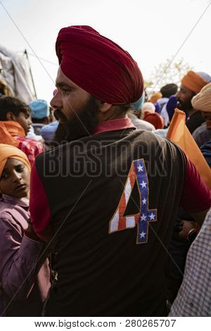 Punjab, India, March 2, 2018: Hola Mohalla Festival - Indian Sikh Wears Jacket Proclaiming His Suppo
