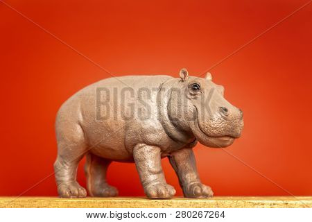 An image of a hippopotamus figure isolated on red background