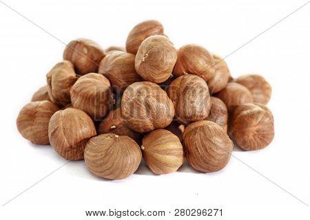 Peeled Hazelnuts On A White Background. Isolated Hazelnut. Without Shells.