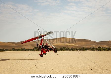 Walvis Bay, Namibia - July 16, 2018: An Ultralight Aircraft Takes Off From An Improved Dirt Runway I