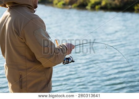 Trout Fishing On The Background Of A Lake