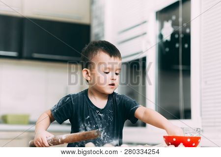 The child makes dough dumplings or dumplings is fun with enthusiasm poster