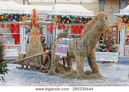 Moscow, Russia - February 12, 2018: Straw Shrovetide Doll And Horse At Russian National Festival