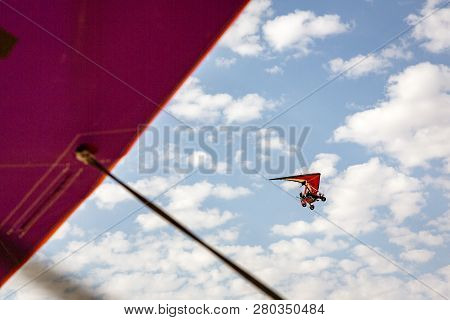 Walvis Bay, Namibia - July 16, 2018: An Ultralight Aircraft Is Seen Flying With Clouds As A Backdrop