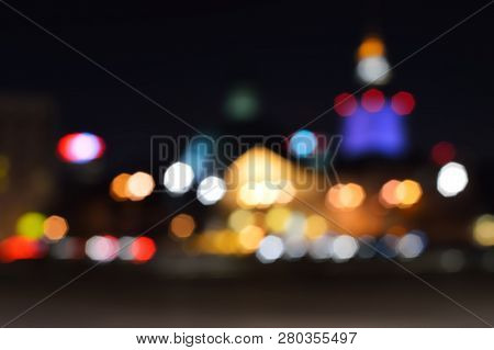 Blur Lights Cityscape In Night For A Background. Bokeh Defocused Night Lights In A City, Warsaw.