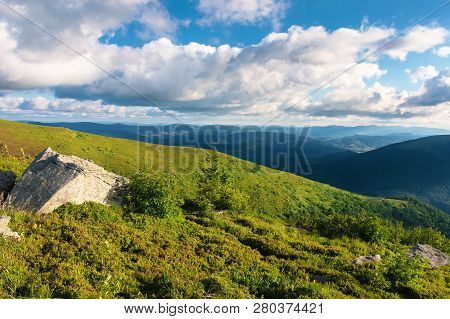 Wonderful Mountain Landscape. Beautiful View In To The Distant Valley. Fluffy Clouds On The Sky. Pea