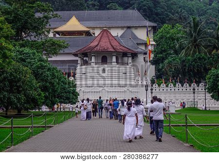 Kandy, Sri Lanka - Dec 15, 2018. White Clothed Buddhist Devotees Visit Temple Of The Sacred Tooth Re