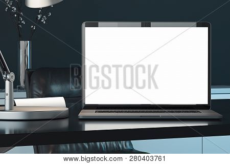 Laptop With Blank White Screen, Switched-on Lamp On Table. 3d Rendering.