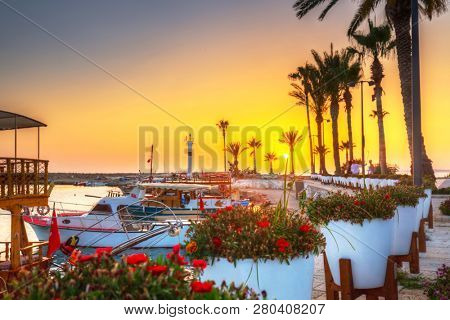Beautiful harbour with boats in Side at sunset, Turkey
