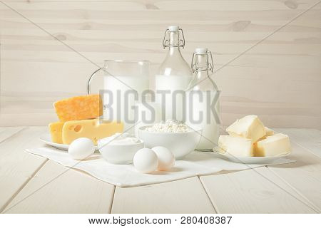 Milk, Cottage Cheese, Sour Cream, Cheese, Butter, Eggs, Still Life From Fresh Dairy Products. The Us