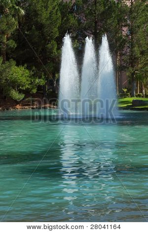 An oasis in the desert. Three magnificent fountain in the expensive hotel