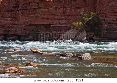 Sporting young woman in a kayak overcame stormy over the Colorado River