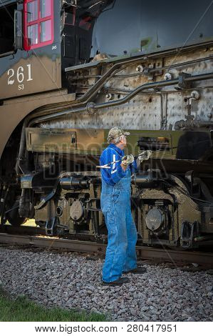 Bongards, Mn - September 8, 2018: Crew Member Does Maintenance Work On The Steam Engine Milwaukee Ro