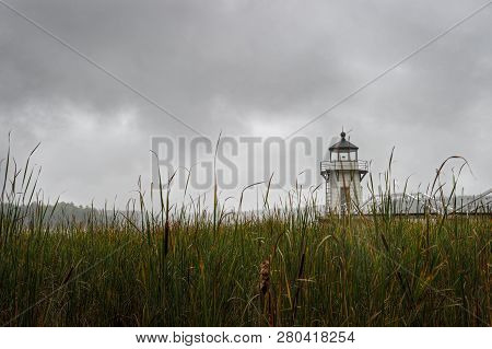 Doubling Point Lighthouse Over Cattail Stand In Fog - Arrowsic Island, Kennebec River, Maine, Usa